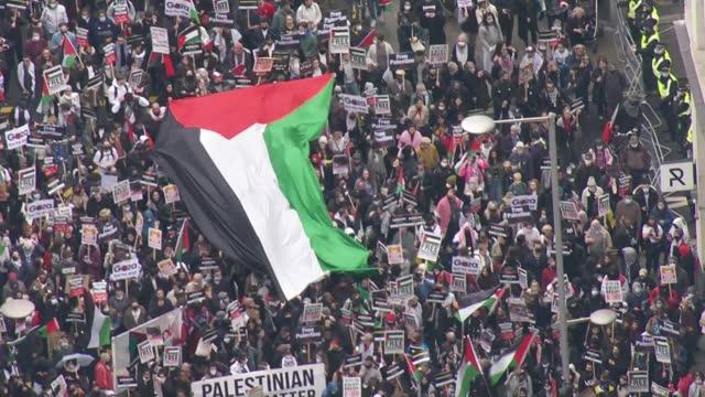 israel destroys gaza tower block housing international media organisations / pro-palestine protest march in london; england: london: ext air views... - パレスチナ文化点の映像素材/bロール