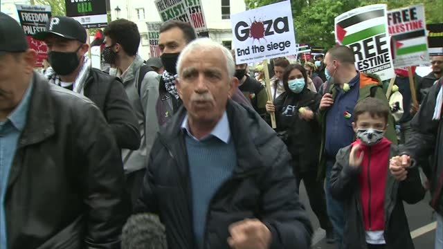 israel destroys gaza tower block housing international media organisations / pro-palestine protest march in london; england: london: ext vox pops - war and conflict stock videos & royalty-free footage