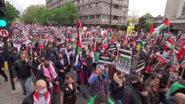 israel destroys gaza tower block housing international media organisations / pro-palestine protest march in london; england: london: ext people... - パレスチナ自治区点の映像素材/bロール