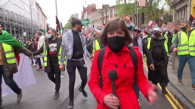 israel destroys gaza tower block housing international media organisations / pro-palestine protest march in london; england: london: ext various of... - war and conflict stock videos & royalty-free footage