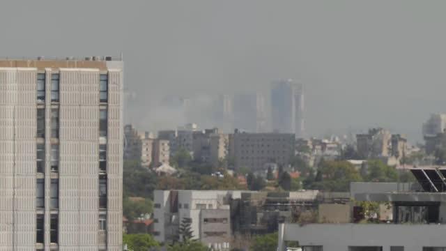 israel destroys gaza tower block housing international media organisations / pro-palestine protest march in london; israel: tel aviv: ext various of... - ガザ地区点の映像素材/bロール