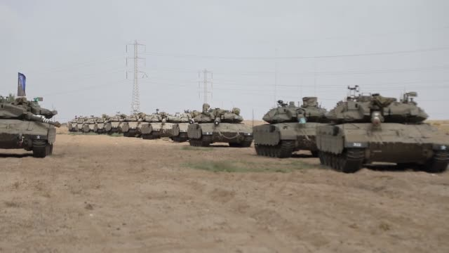 vídeos de stock e filmes b-roll de israel has deployed fresh troops and tanks to the gazaisrael buffer zone in anticipation of weekly friday protests against its 12year blockade of the... - israel