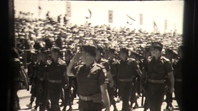 israel independence day parade, holiday celebration party with marching military, tanks and crowd of flags - independence video stock e b–roll