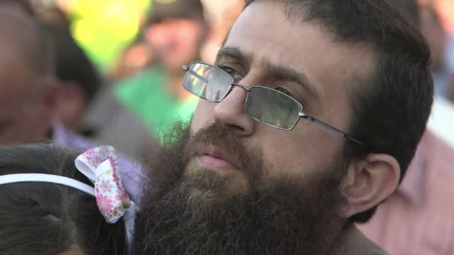 israel on sunday released a palestinian prisoner who staged a 56day hunger strike that brought him near death in a protest against a controversial... - prisoner stock videos and b-roll footage