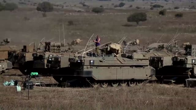 israel said it carried out an air raid friday that killed up to five iran backed militants it said were behind a rare rocket attack from across the... - air raid video stock e b–roll