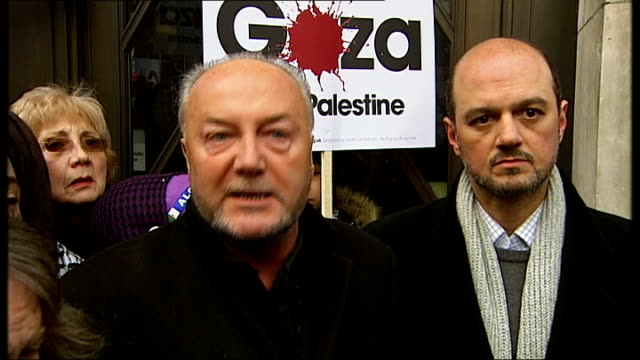 bbc refuses to air gaza appeal *** some george galloway mp speaking to press sot woman with palestinian flag by sign on wall for the british... - israel palestine conflict stock videos and b-roll footage