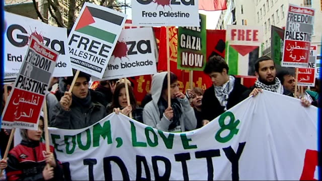 bbc refuses to air gaza appeal rally and protest march in london england london ext propalestine protesters holding banners and placards and chanting... - israel palestine conflict stock videos and b-roll footage