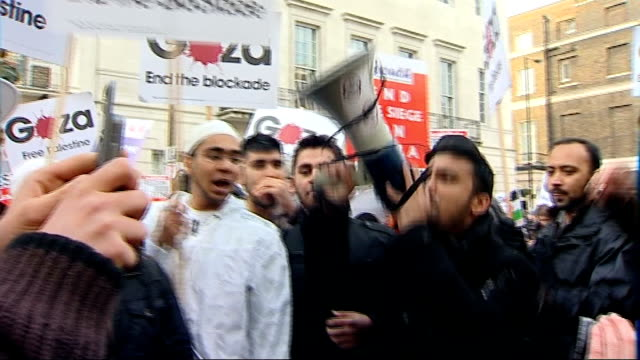 bbc refuses to air gaza appeal rally and protest march in london more of protesters holding placards many reading 'gaza end the blockade' and... - israel palestine conflict stock videos and b-roll footage