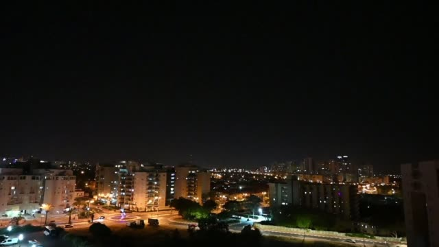 israeli air defence system iron dome intercepts rockets fired from the gaza strip over the israeli town of ashkelon - ashkelon stock videos and b-roll footage