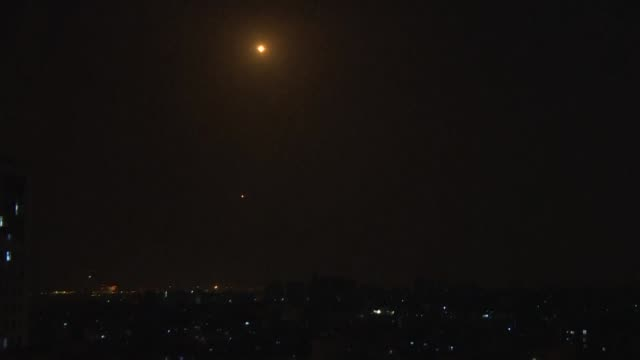 israeli air defence system iron dome intercepts rockets fired from the gaza strip into israel - israel stock videos & royalty-free footage