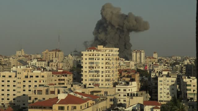israeli air strikes hit buildings in gaza city. heavy exchanges of rocket fire and air strikes, and rioting in mixed jewish-arab towns, fuelled fears... - striscia di gaza video stock e b–roll