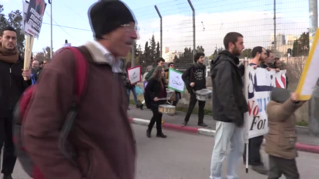 israeli and foreigner peace activists stage a protest against israeli authorities' decision on evacuating palestinian families those who live in... - jerusalem stock videos & royalty-free footage