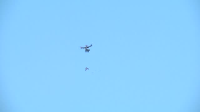 israeli armed forces use drones to drop tear gas canisters in a bid to disperse the palestinians during to mark the passage of 70 years since... - bombola video stock e b–roll