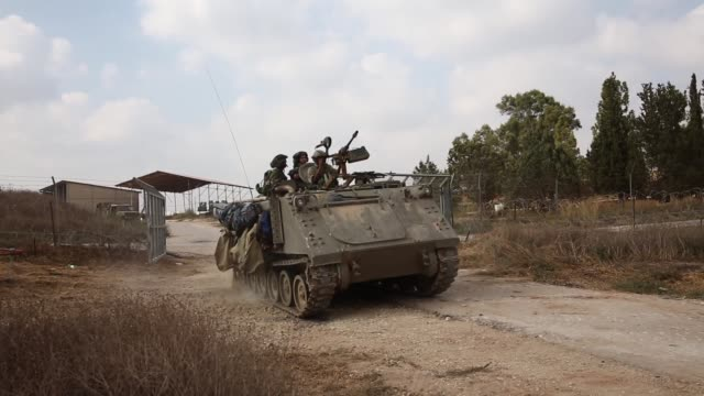 israeli armoured vehicle driving down a road close to the gaza strip. 42 israeli soldiers and over 1,000 palestinians have been killed as the israeli... - ceasefire stock videos & royalty-free footage