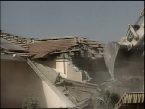 israeli army bulldozer demolishes settler's house during israeli withdrawal from gaza strip katif; 21 aug 05 - palestinian territories stock videos and b-roll footage