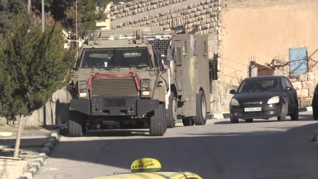 israeli army raids palestinian homes in jenin after a car-ramming attack which injures 12 israeli soldiers on february 06, 2020. in a statement, the... - israeli military stock videos & royalty-free footage