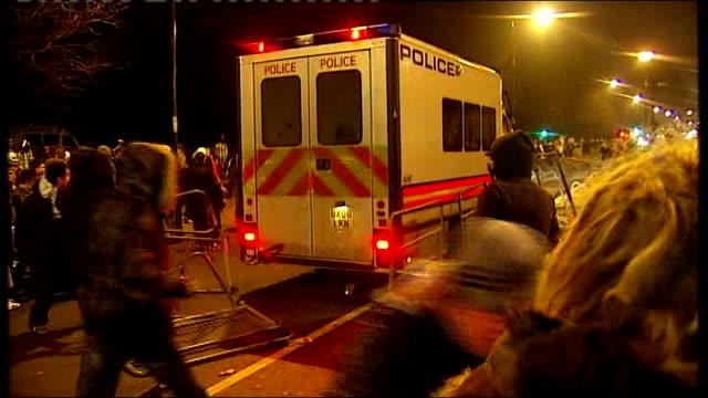 vídeos y material grabado en eventos de stock de aftermath of protest outside israeli embassy in london / proisrael rally in trafalgar square protesters against israeli action in gaza throwing... - placard