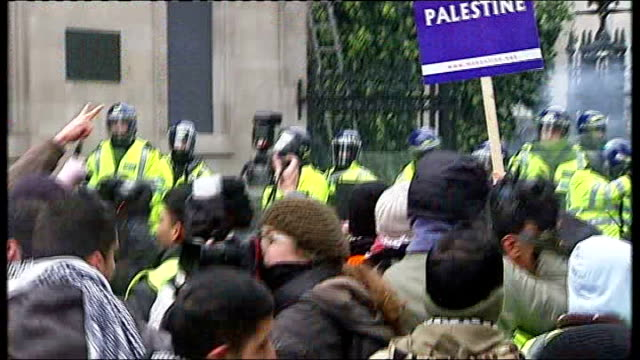vídeos y material grabado en eventos de stock de demonstration and rally in london england london ext protesters against israeli bombing of gaza gathered outside israeli embassy with posters and... - placard