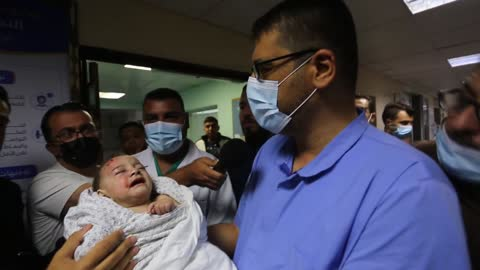 israeli attacks on the blockaded gaza strip killed three more palestinians early saturday, taking the death toll to 136, according to gaza's health... - パレスチナ文化点の映像素材/bロール