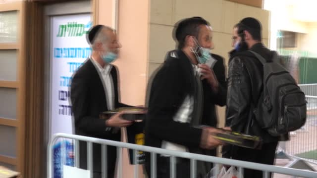 israeli authorities distribute pizzas at a vaccination centre in the mainly ultra-orthodox city of bnei brak, in a bid to encourage more vaccinations... - aggression stock videos & royalty-free footage