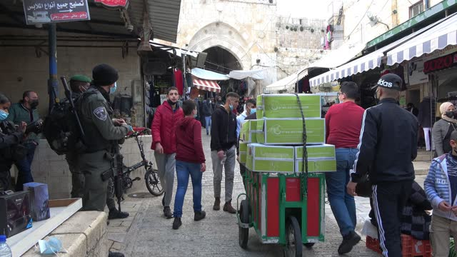 israeli border police stand guard as people walk along al-wad street one of the busiest, most vibrant souks in the old city on february 21 in... - economy stock videos & royalty-free footage