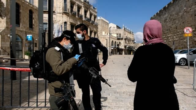 israeli border police woman wearing protective mask checking id of an israeli arab woman in a checkpoint placed in the old city of jerusalem during... - israeli military stock videos & royalty-free footage