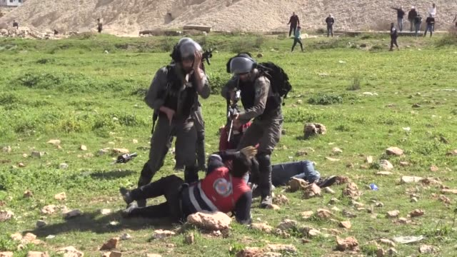 israeli border policemen scuffle with palestinian medics as they give aid to injured demonstrators during a protest by students of the birzeit... - palestinian stock videos & royalty-free footage