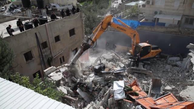 israeli bulldozers demolish a palestinian house in the east jerusalem neighborhood of silwan on february 07 2018 - east jerusalem stock videos and b-roll footage