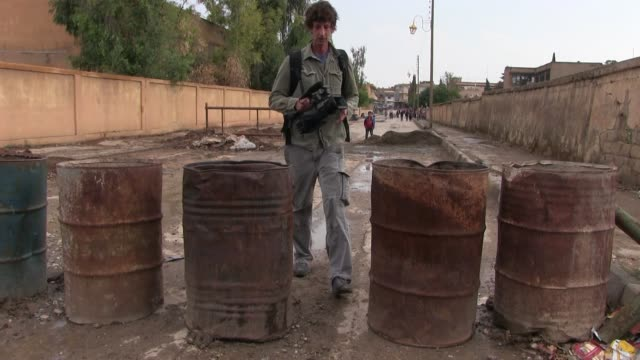 israeli filmmaker itai anghel crosses at a barricade made of barrels set up by fighters of the kurdish people's protection units ypg in the city of... - people's protection units stock videos & royalty-free footage