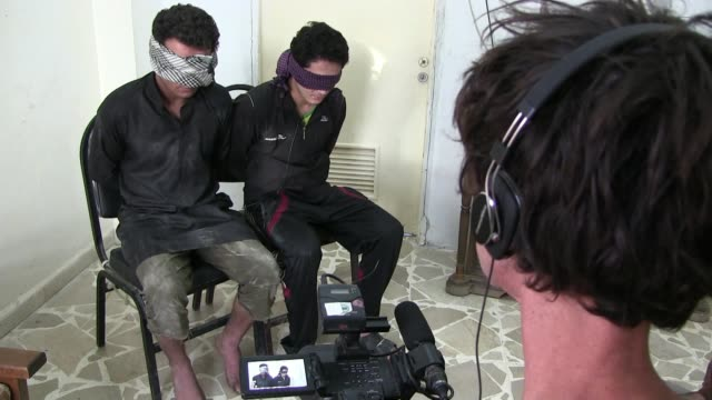 israeli filmmaker itai anghel filming blindfolded detainees suspected to be isis or isil militants captured by fighters of the kurdish people's... - people's protection units stock videos & royalty-free footage