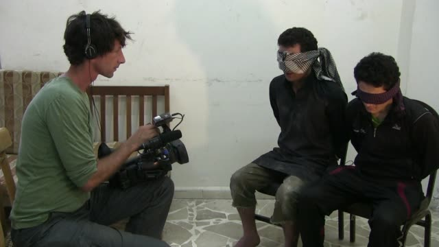 israeli filmmaker itai anghel films blindfolded detainees suspected to be isis or isil militants captured by fighters of the kurdish people's... - people's protection units stock videos & royalty-free footage