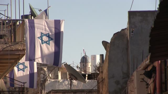 israeli flags hanging from a house which jewish settlers took over in el wad street also called by israelis haggai street in the muslim quarter, old... - eddie gerald stock videos & royalty-free footage