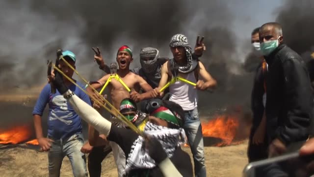 "israeli forces clash with palestinians as they continue to rally as part of the ""great march of return"" near the gazaisrael border on may 11 2018 in... - historical palestine stock videos & royalty-free footage"