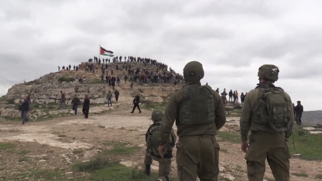 israeli forces clash with palestinians who protest against israeli settlement activities at the jabal al-urmah at beita village near the west bank... - palestinian stock videos & royalty-free footage