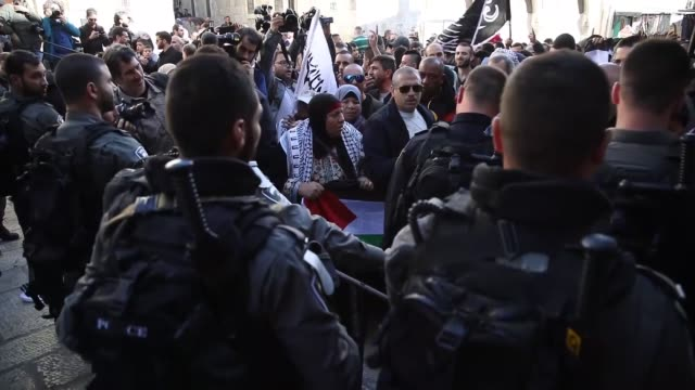 israeli forces clash with palestinians who protest us president donald trump's recognition of jerusalem as israel's capital following the friday... - al aqsa mosque stock videos and b-roll footage