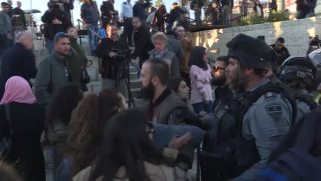 israeli forces clash with palestinians who protest us president donald trump's recognition of jerusalem as israel's capital following the friday... - パレスチナ文化点の映像素材/bロール