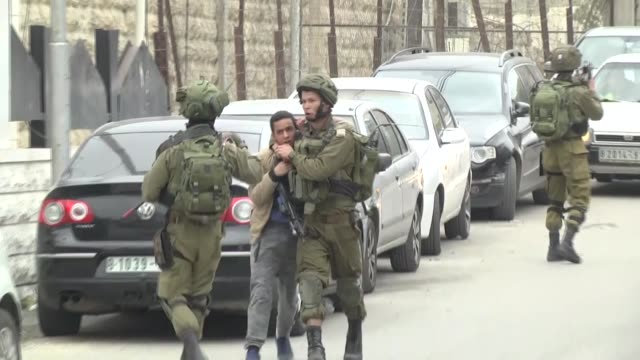 Israeli forces clash with Palestinians who protest US recognition of Jerusalem as the Israeli capital on December 13 2017 in Hebron West Bank At...