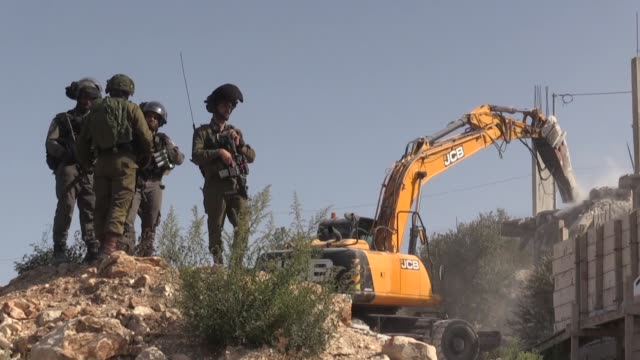 israeli forces clash with palestinians who try to prevent soldiers' attempts to demolish a house in al-walaja village near the west bank city of... - israeli military stock videos & royalty-free footage