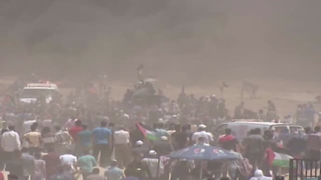 israeli forces fire tear gas at palestinians who take part in rallies aimed to commemorate the nakba anniversary and protest relocating the u.s.... - anniversary stock videos & royalty-free footage