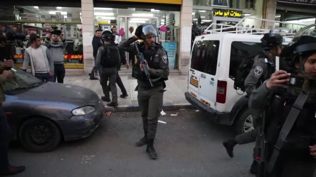 Israeli forces intervene the demonstrators during a protest against US President Donald Trump's announcement to recognize Jerusalem as the capital of...
