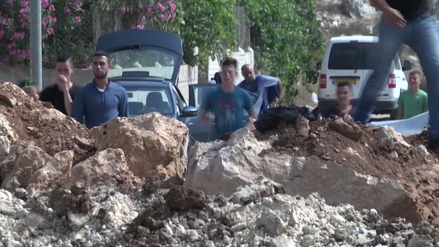 israeli forces on july 22 2017 slapped a siege around the hometown of a palestinian man who allegedly killed three jewish settlers in a nearby... - hometown stock videos and b-roll footage