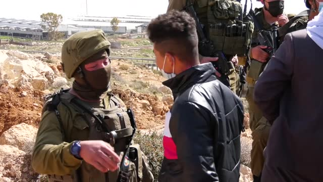 israeli forces on monday arrested two palestinian farmers protesting israeli destruction of their lands south of the southern west bank city of... - hebron west bank stock videos & royalty-free footage