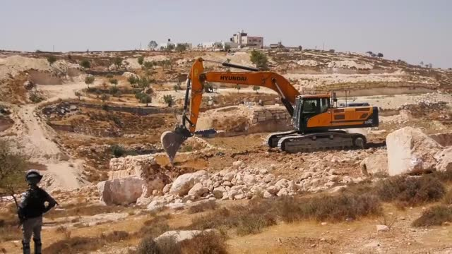 israeli forces on wednesday demolished a palestinian house, a vehicle repair workshop, and bulldozed an olive orchard in the southern west bank,... - house stock videos & royalty-free footage