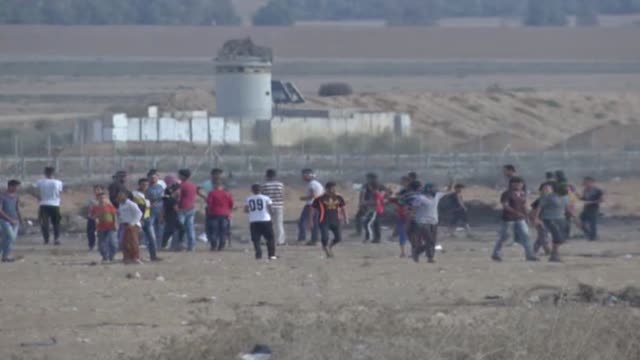 israeli forces use tear gas to disperse palestinian demonstrators during the great march of return demonstration near israelgaza border in east of... - historical palestine stock videos & royalty-free footage