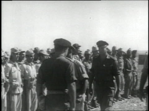israeli general moshe dayan walks past a row of soldiers standing at attention after the six day war in israel in the late 1960s - israel stock-videos und b-roll-filmmaterial