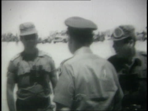 Israeli generals shaking hands and embracing
