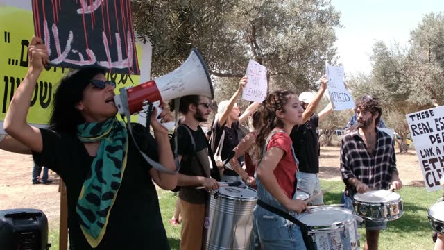 israeli left-wing activists take part in a demonstration against evacuation of palestinian families from their home in sheikh jarrah neighborhood,... - campaigner stock videos & royalty-free footage