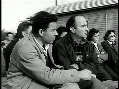 stockvideo's en b-roll-footage met israeli men sitting outdoors listening / israel / documentary - 1948