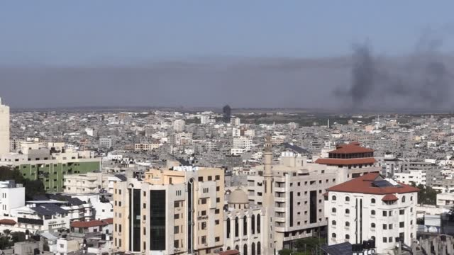 stockvideo's en b-roll-footage met israeli military jets continue to bomb various locations of gaza on tuesday. the number of palestinians killed rose to 28 in raids tuesday by israeli... - bom