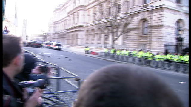 London demonstrations Demonstrators along / Galloway Lennox and Bianca Jagger along in crowd of marchers / Police officers standing behind railings...